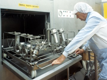 Cleaning pharmaceutical manufacturing equipment